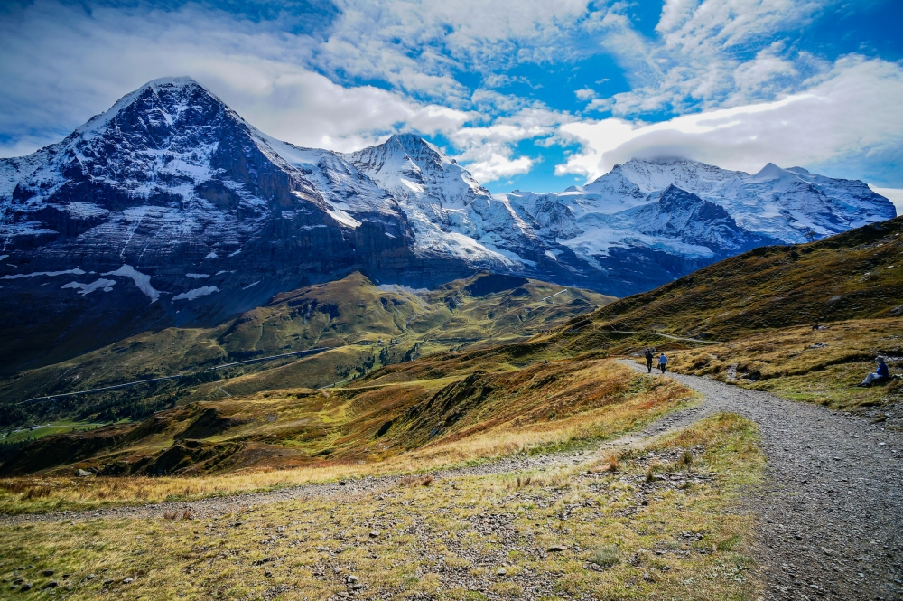 Hiking trail with the Eiger,Monch and Jungfrau summit view.